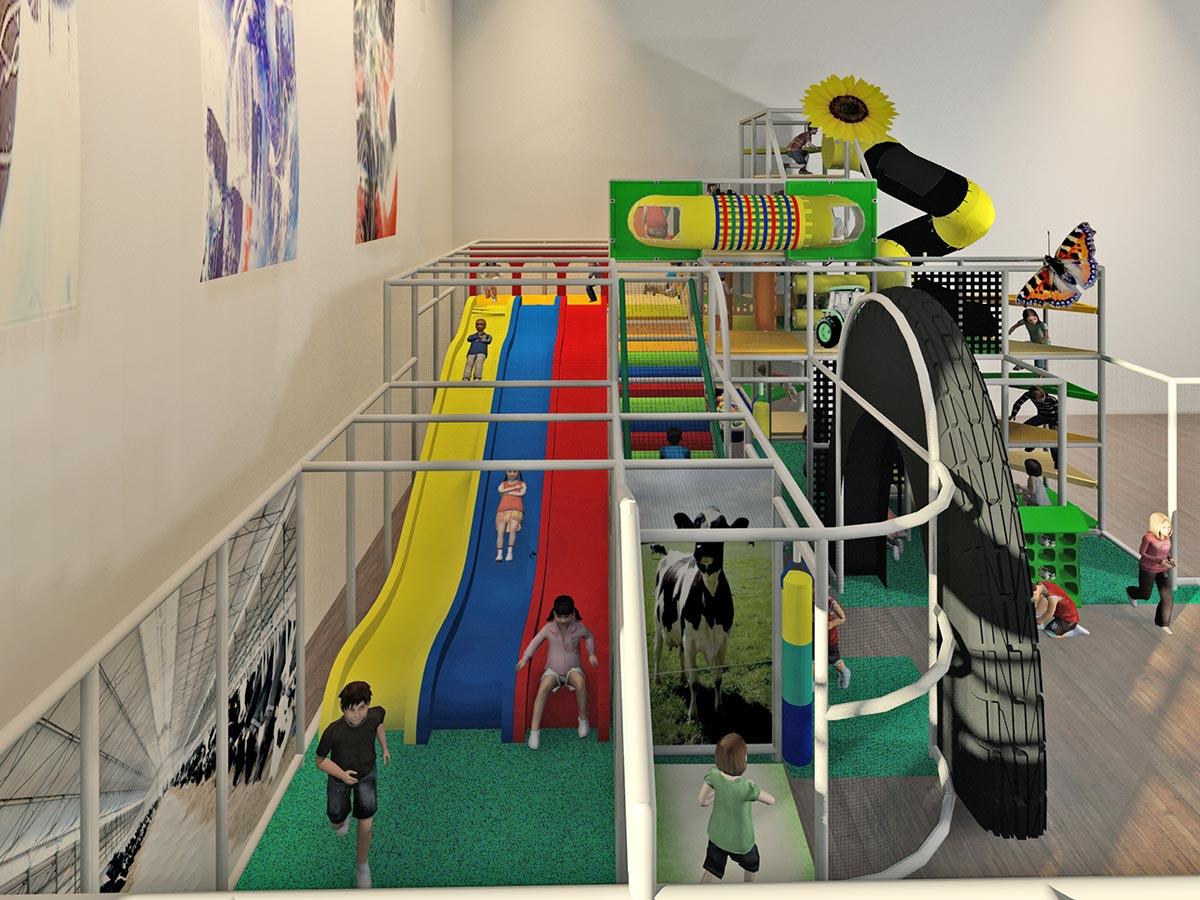 Side view of Low Farm and Top Farm Themed Playground with Triple Slide Visible