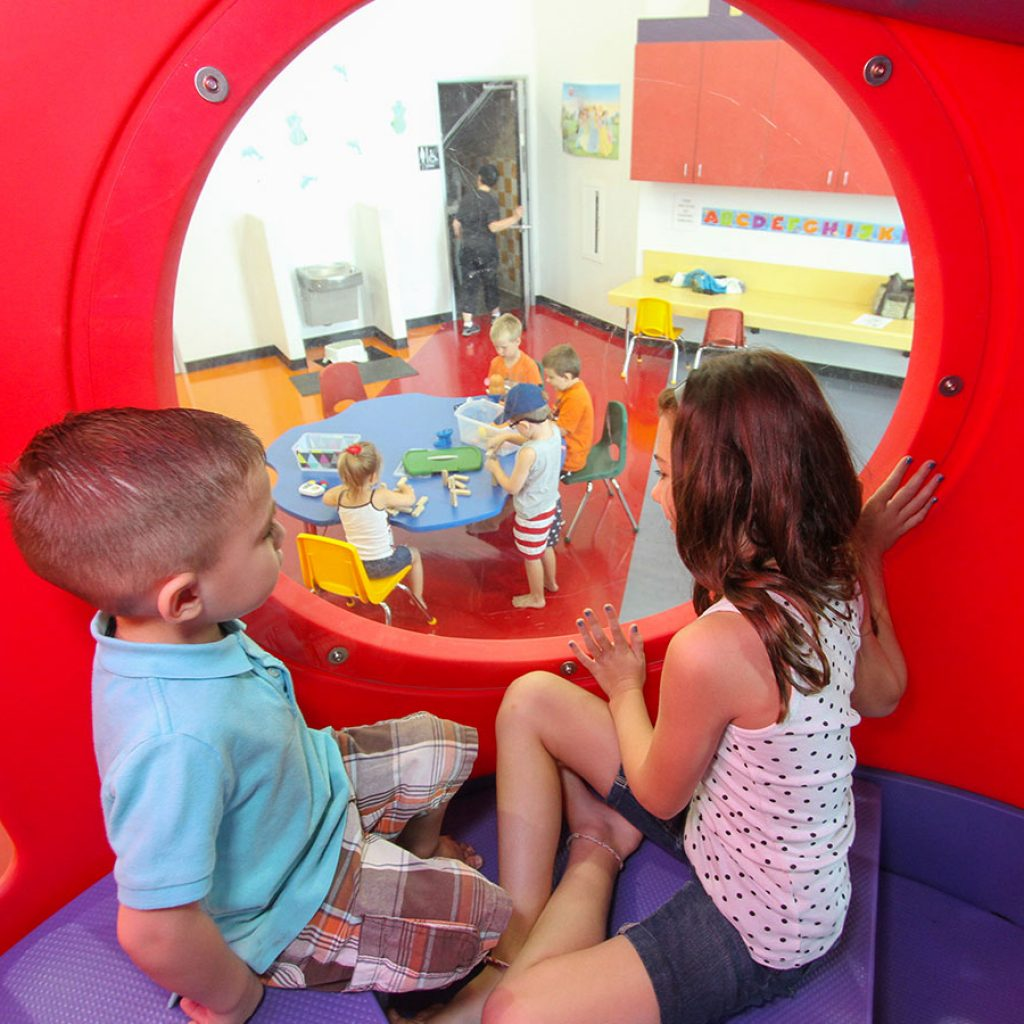 Children play in Soft Play tunnel
