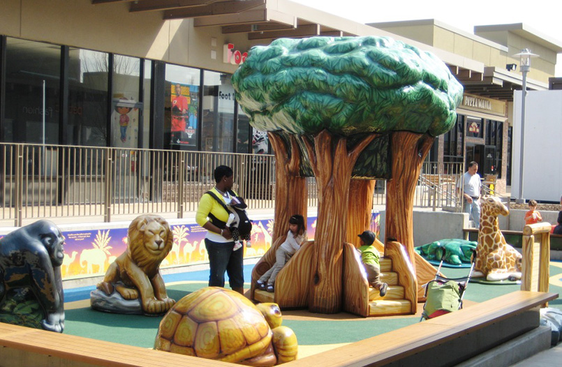 Children playing on zoo themed playground