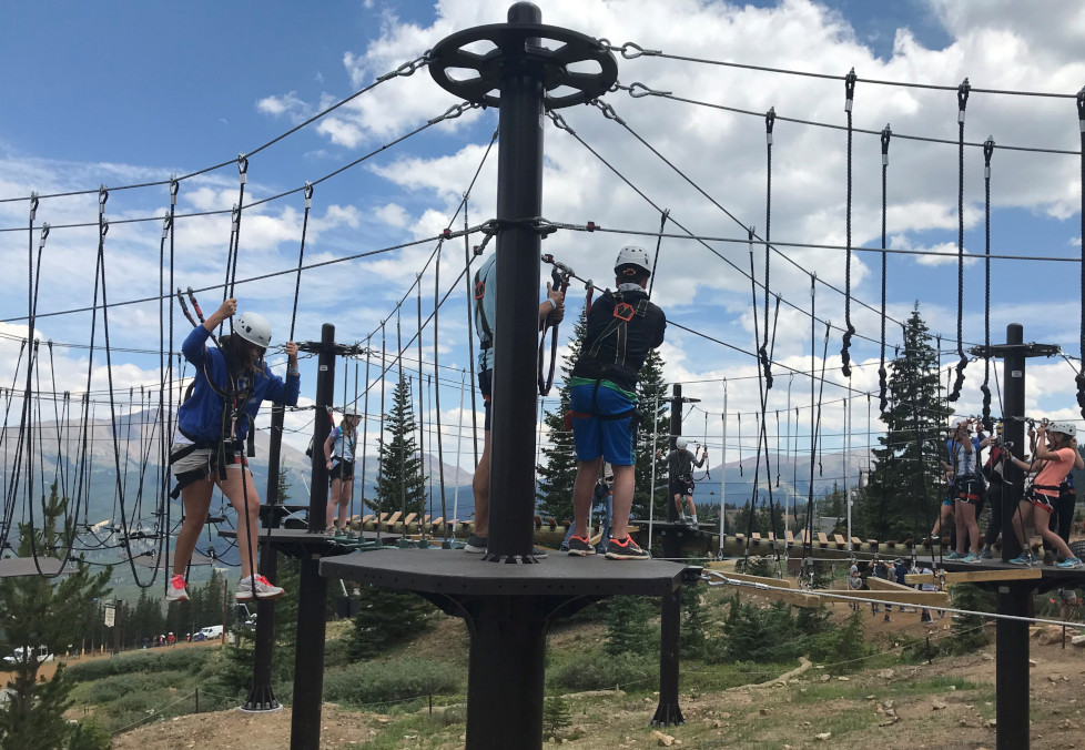 People walking across the Breck High Rope Adventure Course