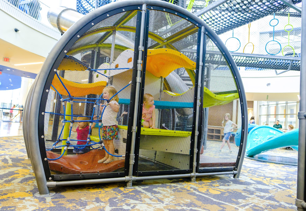 Kids playing in the play structure for children ages five and under