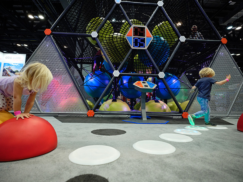 Children running on interactive play elements