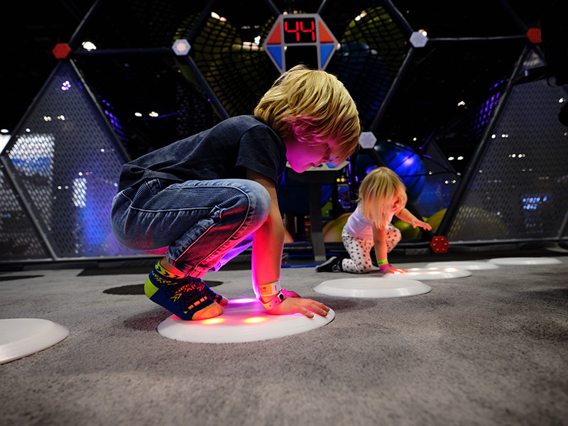 Boy playing with floor interactive play element