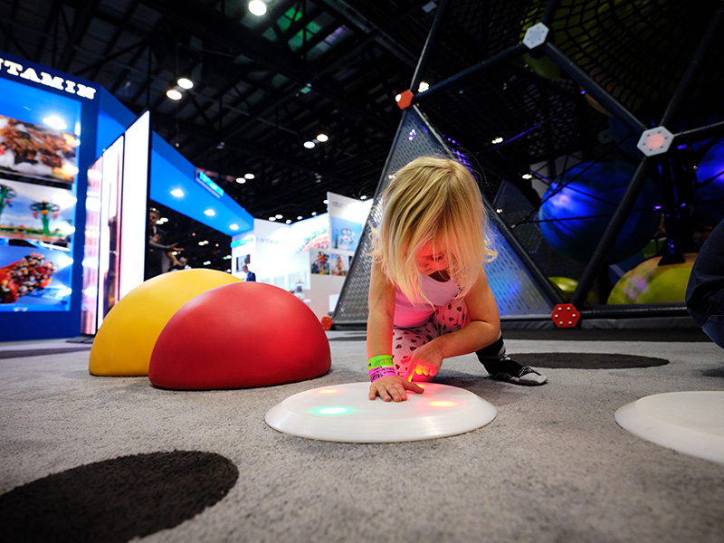 Child playing with interactive floor panels