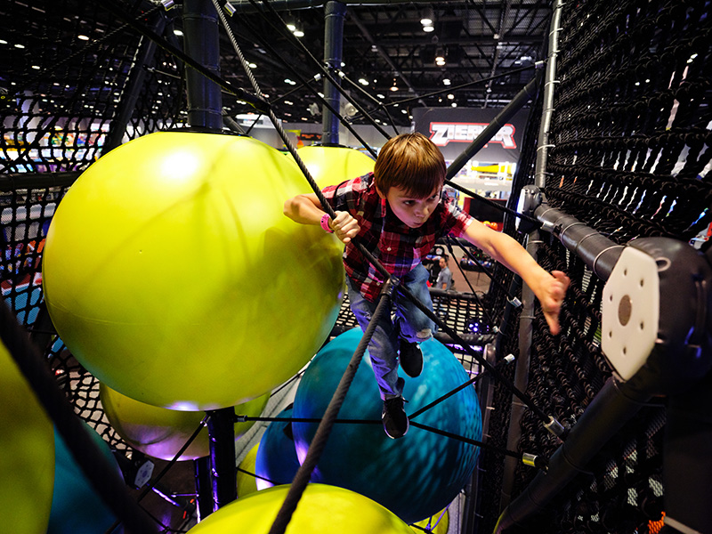 Child playing in hive interactive challenge course