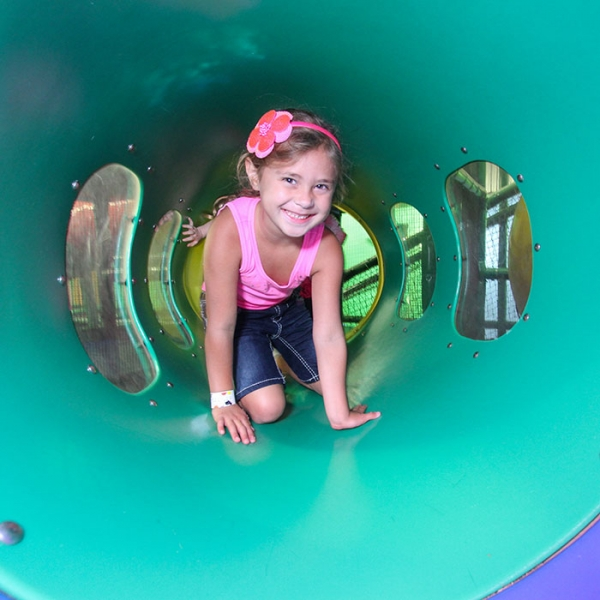 Girl Crawling Through Teal Colored Tunnel FUNWORKS Modesto CA